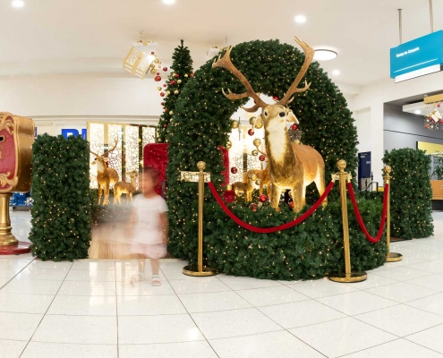 Entrance to the Santa Set at Stockland Riverton Shopping Centre featuring a large Santa's mailbox and moving, animatronic reindeer