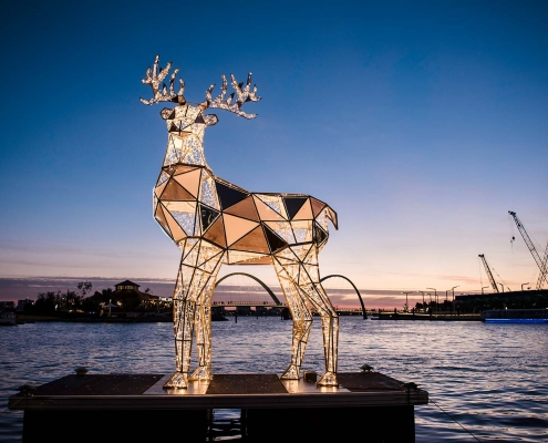 Six and a half metre tall faceted, origami reindeer installed on a pontoon at Elizabeth Quay for the Perth Christmas Lights Trail