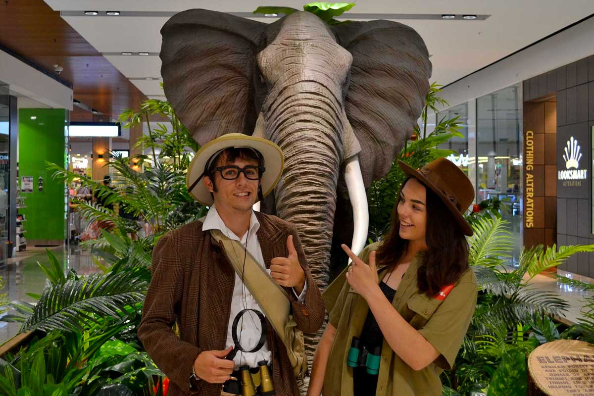 Animatronic Asian Elephant in jungle themed pod with costumed guides at Stockland Baldivis Shopping Centre