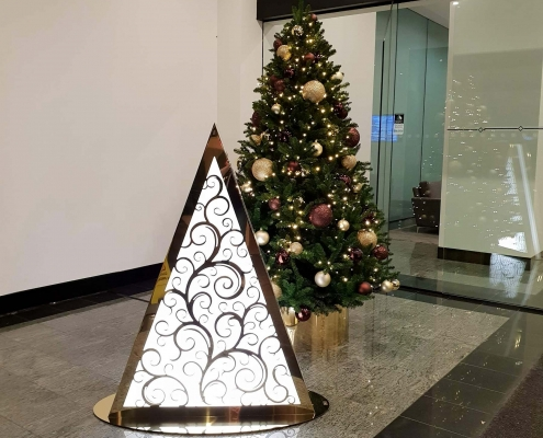 Traditional 1.8m Christmas tree and custom-designed light tree in the corporate foyer of 256 Adelaide Tce, Perth