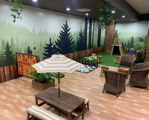 Tenancy Activation featuring a camping themed children's play area with giant board games at Stockland Baldivis Shopping Centre