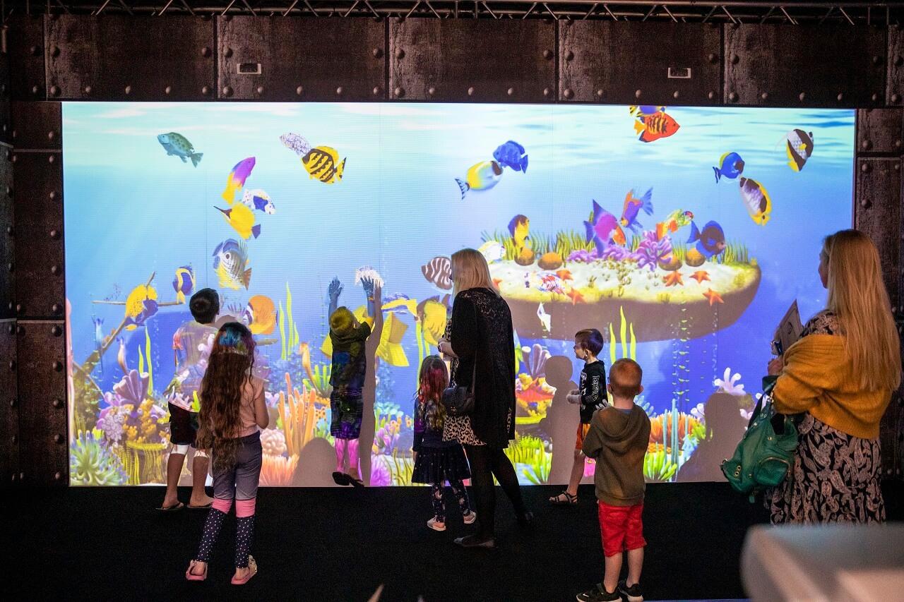 Children interacting with the ArtQuarium screen at Ocean Keys Shopping Centre