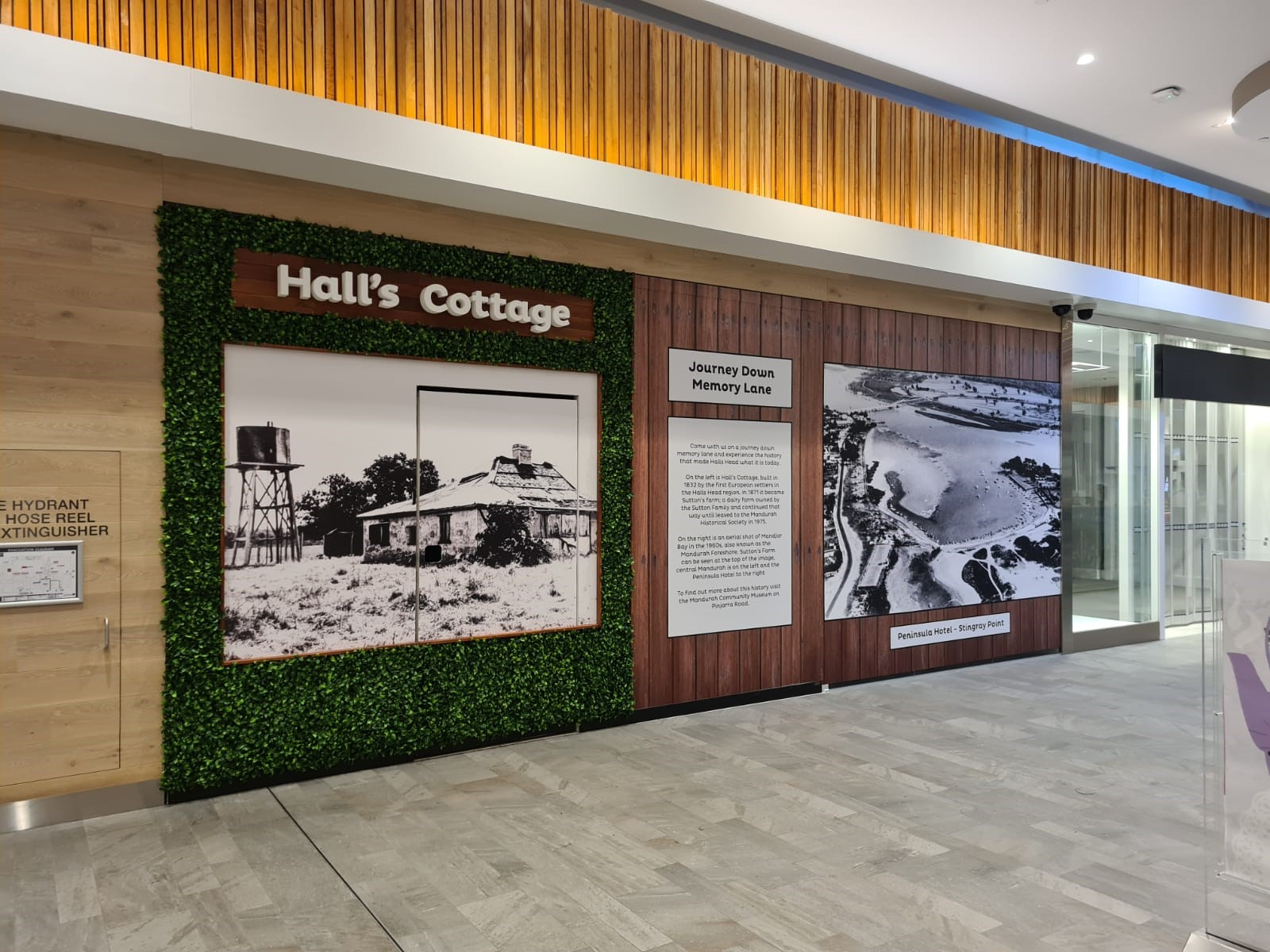 Decorative display on hoarding installation at Halls Head Central Shopping Centre